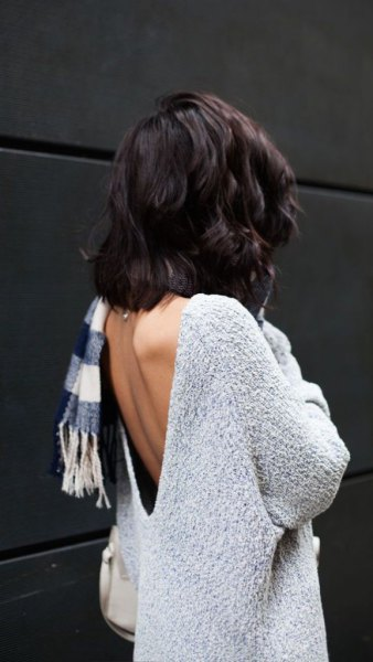 light mottled gray sweater with checkered scarf