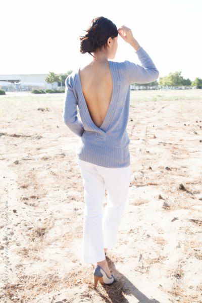 light sky blue sweater with open back and white skinny jeans