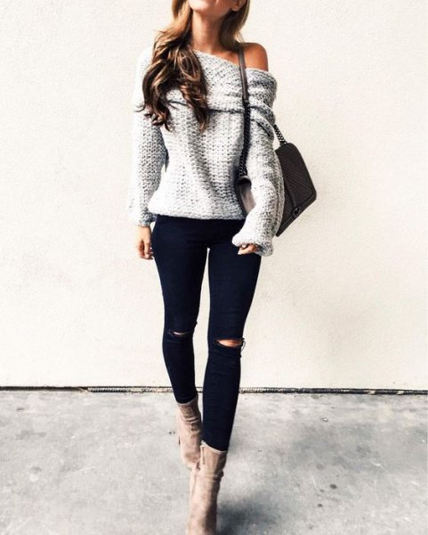 gray, strapless knit sweater with black knee jeans