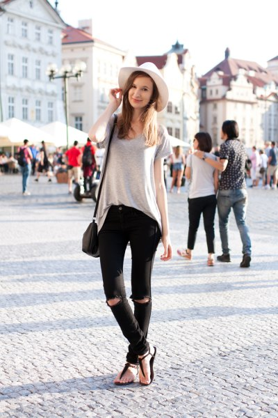 gray oversized t-shirt with black jeans and sandals