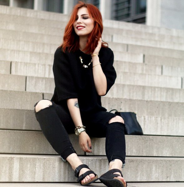 black sweater with knee-high jeans and slide sandals