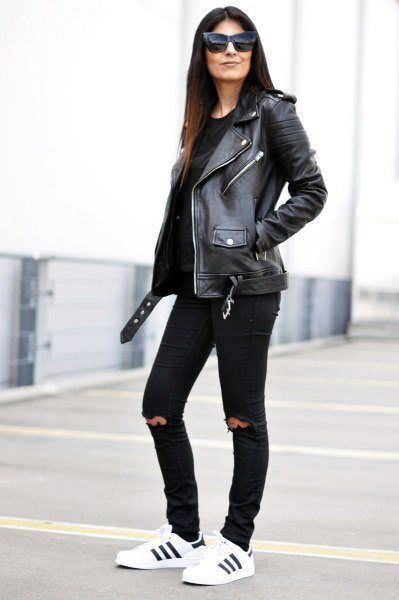 black leather biker jacket with knee-ripped slim fit jeans