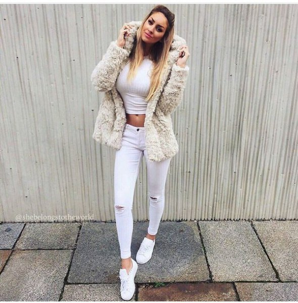 Fuzzy faux fur jacket with white ankle jeans
