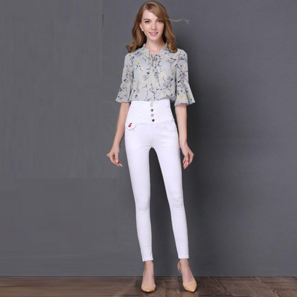 Blush pink printed chiffon bell sleeve blouse with white button placket and high waisted jeans
