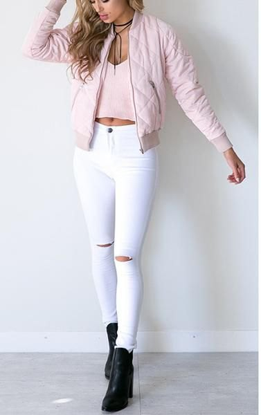 Light pink quilted bomber jacket with high waisted white skinny jeans