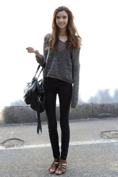gray, strapless sweater with black skinny jeans