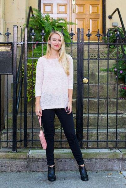 white, semi-transparent slouchy sweater with a boat neckline and black jeans