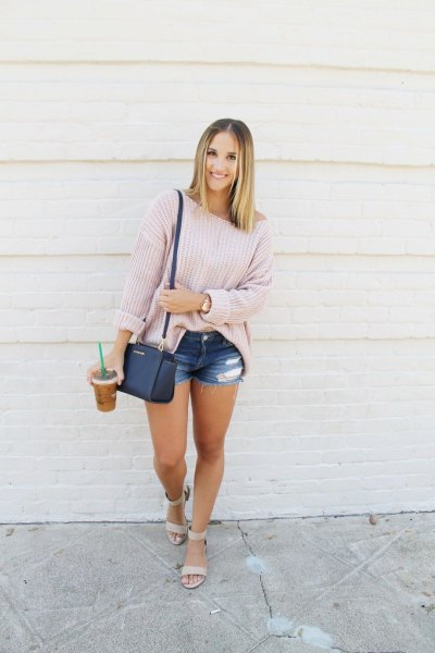 Light gray oversized sweater with blue denim shorts