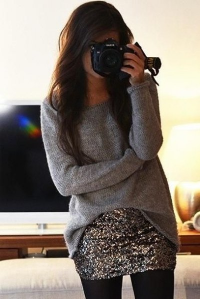 gray oversized slouchy sweater with silver sequin mini skirt