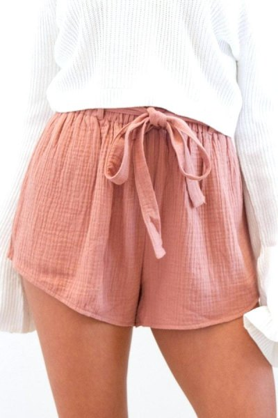 white, ribbed, oversized knit sweater with pink tie-mini chiffon shorts with elastic waist at the front