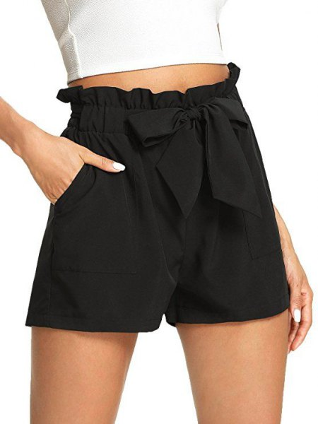 white cut, fitted t-shirt with black, elastic waist shorts