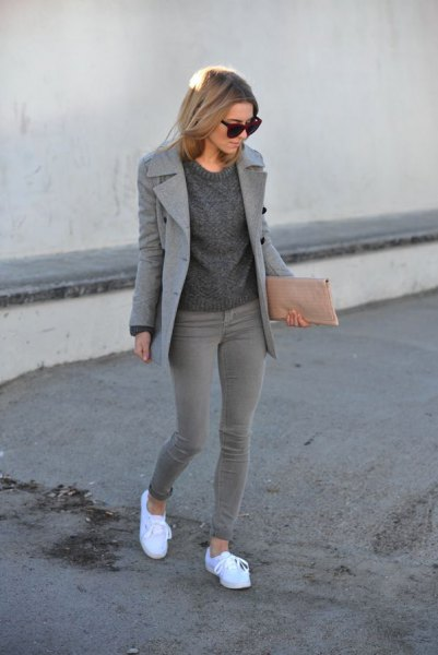 Wool coat with knitted sweater with a round neck and gray skinny jeans