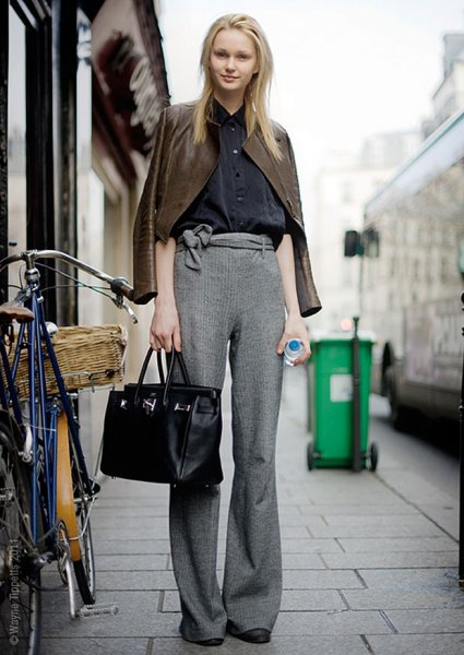 brown leather jacket with gray mottled knit pants with wide legs