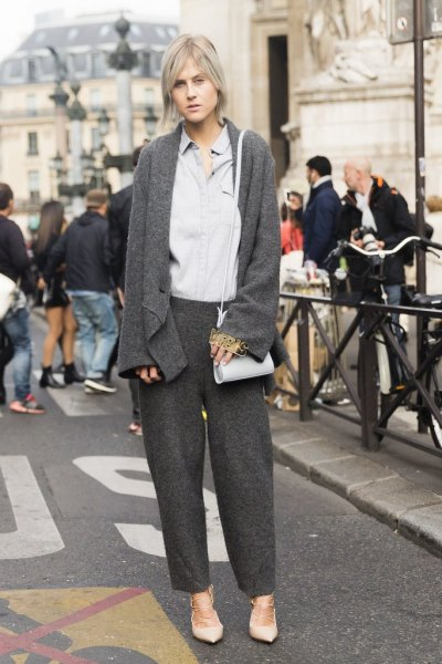 gray cardigan with matching trousers and light blue shirt