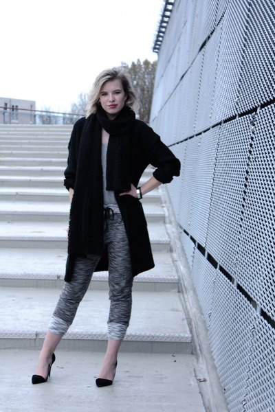 black long wool coat with gray mottled, short-cut knit pants