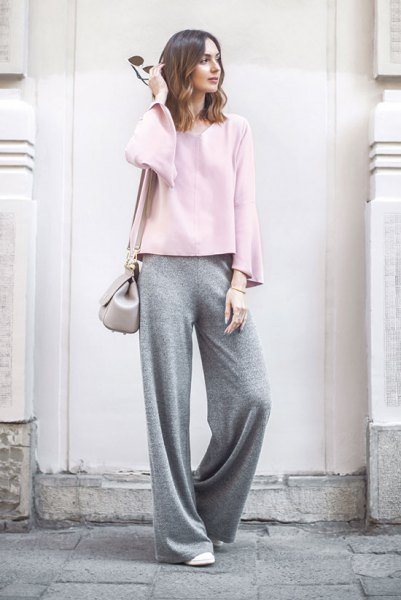 white long-sleeved top with gray trousers with wide legs