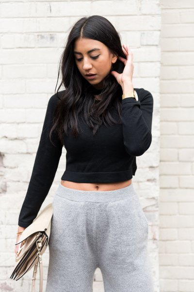 black, short-cut turtleneck with gray knit trousers with wide legs