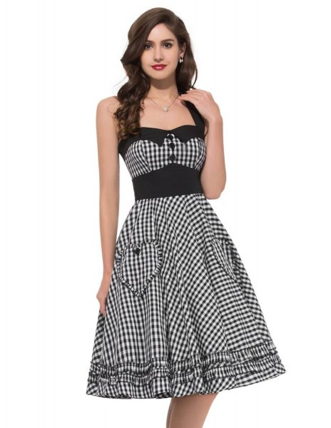 black and white checkered fit and flared midi dress with a square neckline