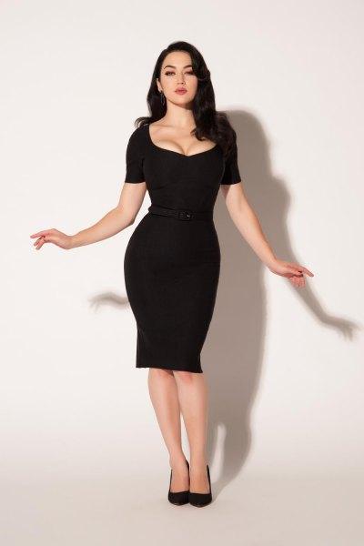 black, knee-length, figure-hugging dress with leather heel