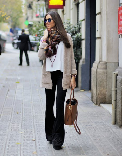 gray cardigan with white chiffon blouse and black flared jeans