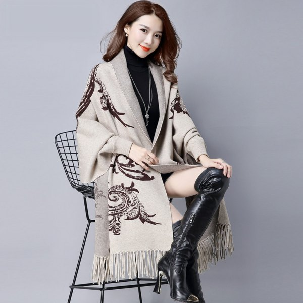 light gray tribal printed long fringed scarf with black, thigh-high leather boots