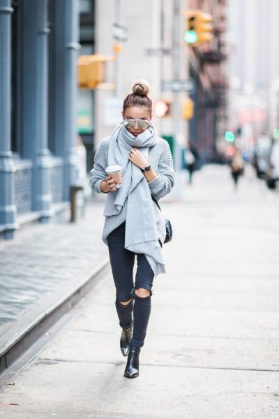gray knitted scarf with torn black skinny jeans