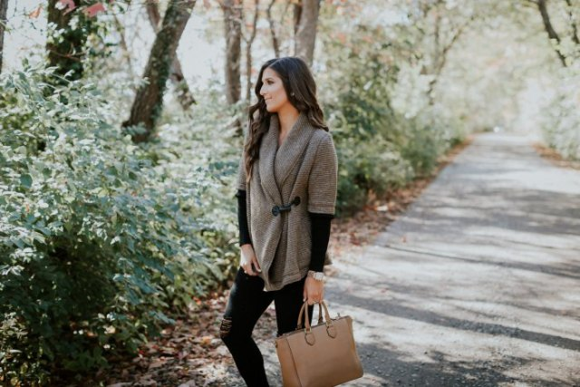 gray half-sleeved sweater with black long-sleeved shirt and brown leather pocket