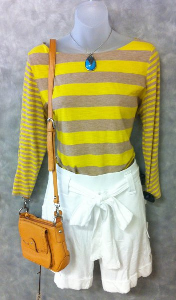 yellow-gray striped long-sleeved T-shirt with white mini shorts with a tie front