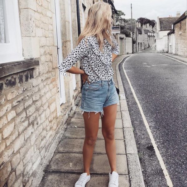 white and black polka dot chiffon blouse with blue high waisted shorts