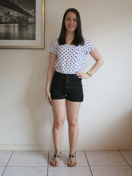 white and black short-sleeved t-shirt with polka dots and mini denim shorts