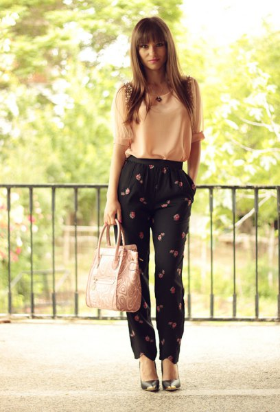 Light yellow chiffon tank top with black trousers with a floral pattern