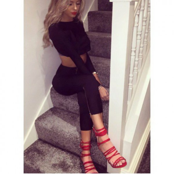 black, shortened sweater with matching skinny jeans and red lace heels
