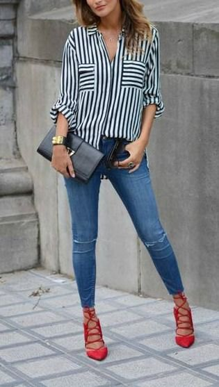 black and white striped shirt with buttons, blue jeans and red lace-up shoes