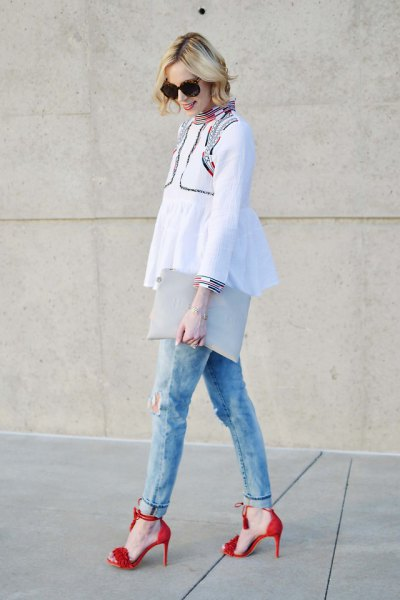 white peplum top with light blue slim fit jeans with cuffs and red heels