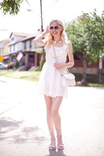 Mini chiffon shift dress made of white lace with lace sandals