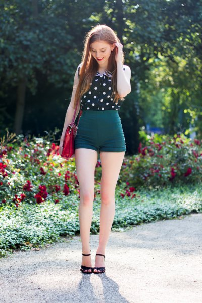 sleeveless shirt with black and white polka dots and high waisted vintage shorts