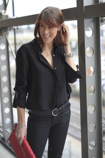 black chiffon button-down shirt with matching skinny jeans with belt