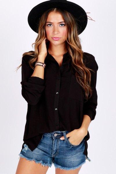 Button-down shirt with blue denim shorts and a black felt hat