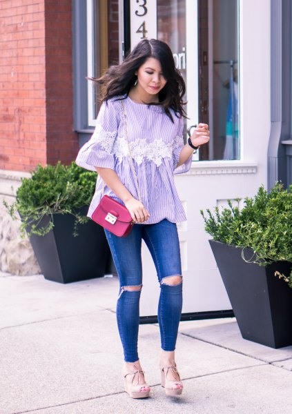blue and white striped bell-sleeved blouse with torn jeans