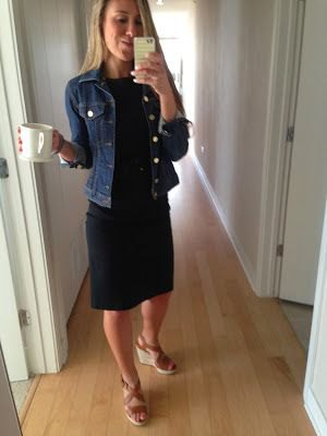 black knee-length dress with blue denim jacket