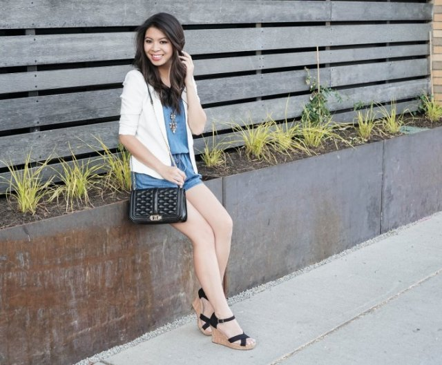white blazer with blue mini shorts and black lace-up sandals