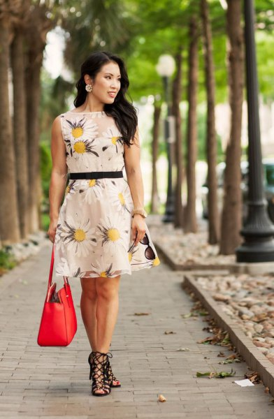 Blush a pink and yellow mini dress with a floral print and sandals