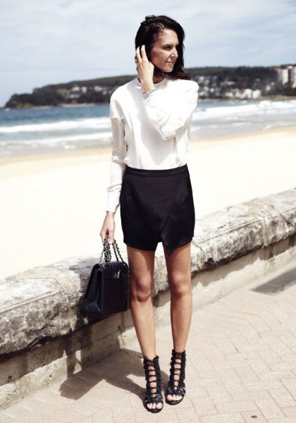 white shirt with buttons, skort and black lace-up sandals