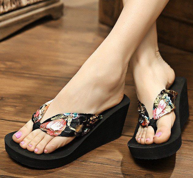 black wedge flip-flops with floral pattern and white mini shift dress