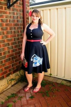 black belted midi dress and flared midi dress with gray flip-flops