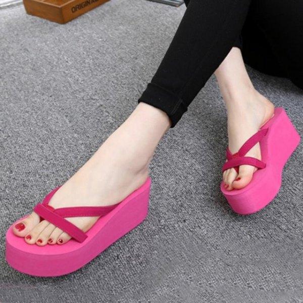 black super skinny jeans with pink high heels flip flops