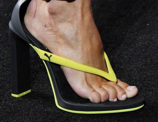 High heels flip flops with yellow and black sports brands and jogging pants