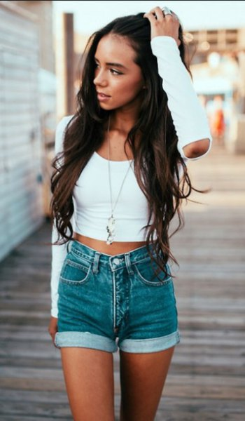 white short t-shirt with short sleeves and gray denim shorts with cuffs