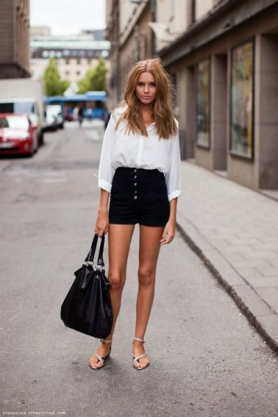 white shirt with buttons and black mini shorts