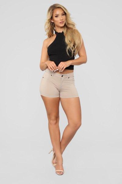 black halter crop top with light pink denim shorts with a high waist